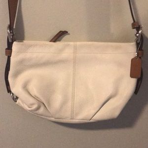 White and brown coach bag